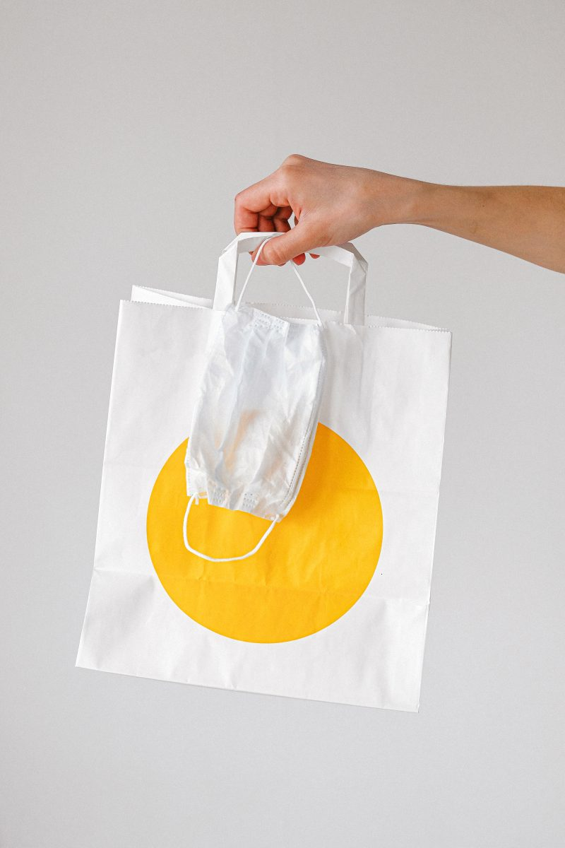 Canva - Person Holding Paper Bag and Face Mask